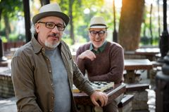 Joyful senior friends playing draughts outdoor Royalty Free Stock Photography