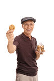 Joyful senior holding a jar with cookies Stock Photo