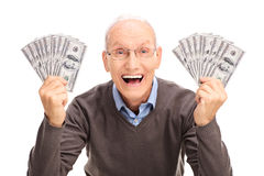 Joyful senior holding money in both hands Royalty Free Stock Photography