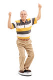 Joyful senior standing on a weight scale Stock Image