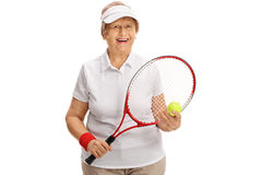 Joyful senior tennis player holding a racket and a tennis ball Royalty Free Stock Images