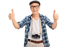 Joyful senior tourist giving two thumbs up Royalty Free Stock Images