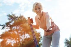 Joyful senior woman calling you Royalty Free Stock Image