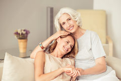 Joyful senior woman resting with her daughter Royalty Free Stock Photos