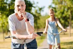 Joyful senior woman riding bicycle with her granddaughter Royalty Free Stock Photo