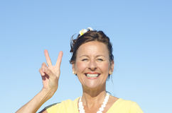Joyful senior woman sky background Stock Images