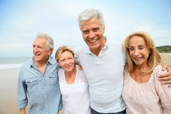 Joyful seniors on the beach Stock Images