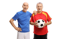 Joyful seniors in jerseys with a football Royalty Free Stock Photo