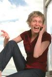 Joyful, shouting woman. Crazy calling woman sitting at the window Stock Photo