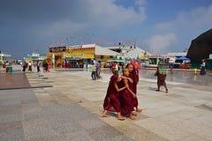Joyful Simple Life of Buddhist Children Monk on huge open space Stock Image