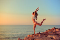Joyful slim lady in bikini jumping standing on Stock Photos