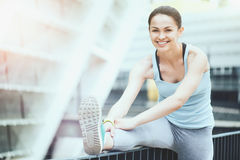 Joyful slim woman enjoying outdoors training. Royalty Free Stock Images