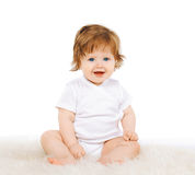 Joyful smiling beautiful baby. Portrait joyful smiling beautiful baby royalty free stock photo