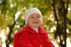 The joyful smiling girl. The joyful smiling little girl stock images