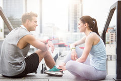 Joyful sporty people spending time together after workout. Royalty Free Stock Photos
