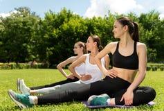 Joyful sporty women doing sport activities Stock Images