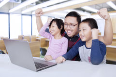 Joyful students and teacher raise hands in class Royalty Free Stock Images