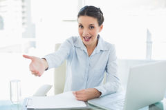 Joyful stylish brunette businesswoman presenting her hand Royalty Free Stock Images