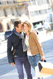 Joyful stylish couple in town on a shopping day Royalty Free Stock Photos