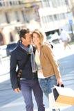 Joyful stylish couple in town on a shopping day. Cheerful couple in town doing shopping Royalty Free Stock Photos