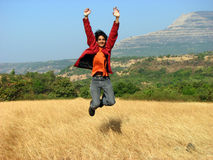 Joyful Success. An Indian youth jumping with joy on winning a competition Stock Image