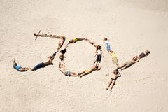 Joyful sunbathers. Image of word joy made up of young people resting on the sand Stock Images