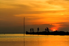 Joyful Sunset. A group of friends are having fun before the sun set under the horizon, create a harmony feeling of the picture Stock Photo