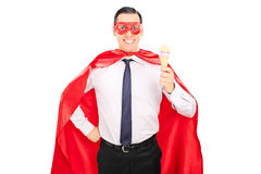 Joyful superhero holding an ice cream Royalty Free Stock Photography