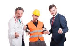 Joyful team made by medic, businessman, and engineer Royalty Free Stock Photo