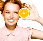 Joyful teen girl with funny red hairstyle. Juicy oranges Stock Photo