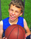 Joyful teenage with a basketball outdoors Royalty Free Stock Image