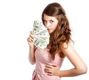 Joyful teenage girl with dollars in her hands Royalty Free Stock Images