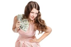 Joyful teenage girl with dollars in her hands Royalty Free Stock Image