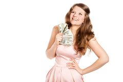 Joyful teenage girl with dollars in her hands Stock Images