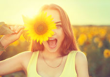 Joyful teenage girl with sunflower. Beauty joyful teenage girl with sunflower Royalty Free Stock Images