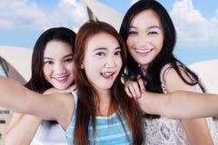Joyful teenage girls taking a selfie in Sydney royalty free stock image
