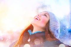 Joyful teenage model girl having fun in winter park stock photography