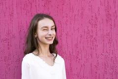 Joyful teenager posing outside stock images