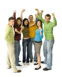 Joyful teenagers. Group of 6 happy teenagers. They're standing with hands up. White background. Whole bodies visible Royalty Free Stock Photos