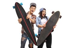 Joyful teenagers with longboards Stock Photography
