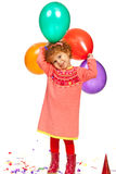 Joyful toddler girl with balloons Royalty Free Stock Photos