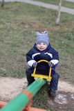 Joyful toddler on seesaw Royalty Free Stock Images