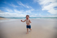 Joyful toddler on a tropical beach Royalty Free Stock Image