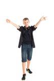 Joyful tonåringpojke. Arkivbilder