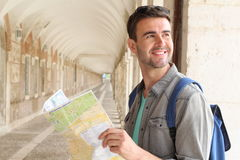 Joyful tourist holding map with copy space.  Stock Images