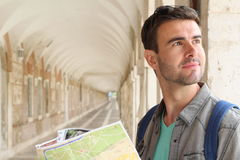 Joyful tourist holding map with copy space.  Royalty Free Stock Photo