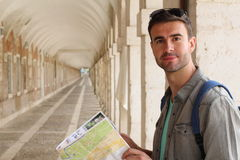 Joyful tourist holding map with copy space.  Royalty Free Stock Image