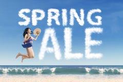 Joyful tourist with spring sale cloud Royalty Free Stock Photos