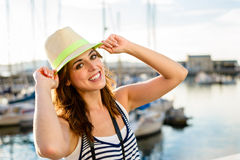 Joyful tourist on summer travel by the harbor Stock Photos