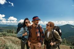 Joyful tourist team are spending funny time in nature stock photos